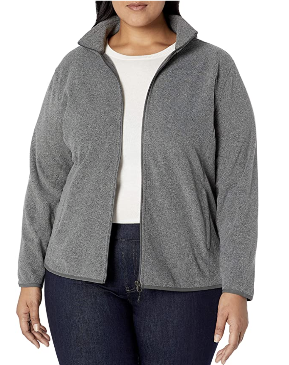 Model in a gray full zip fleece jacket with pockets and a high collar