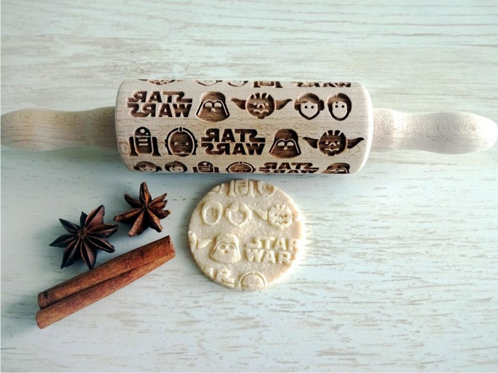 the rolling pin with the Star Wars logo on it and several characters' faces engraved in it