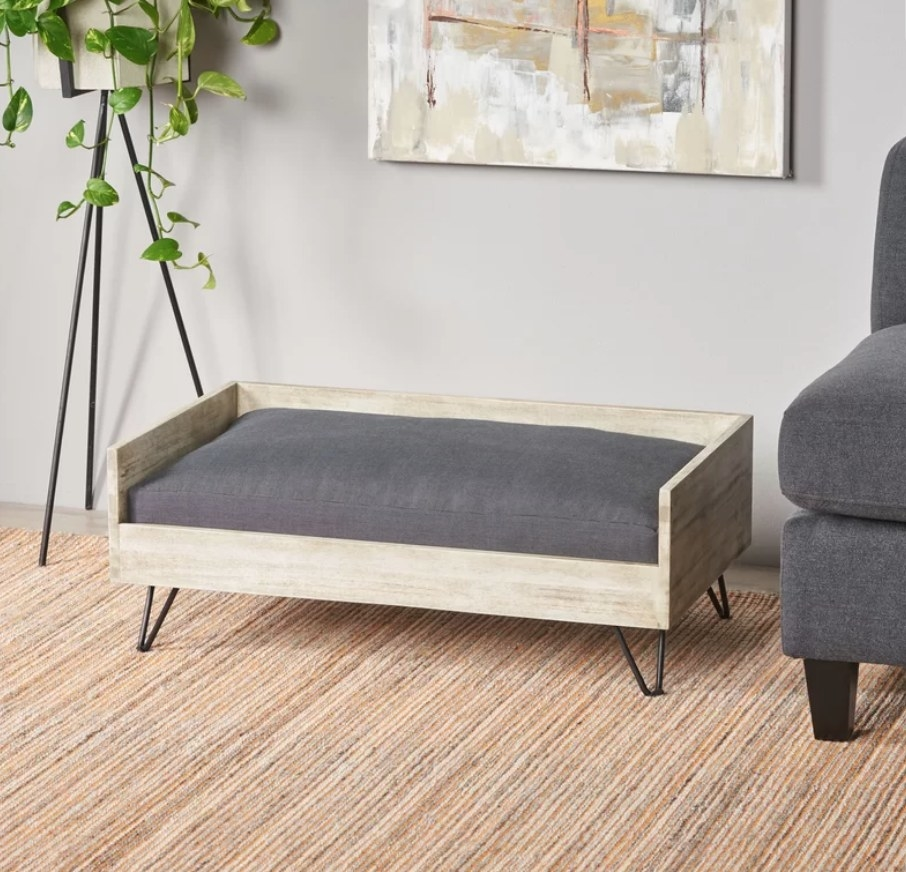 Dog sofa with wooden frame and gray cushion