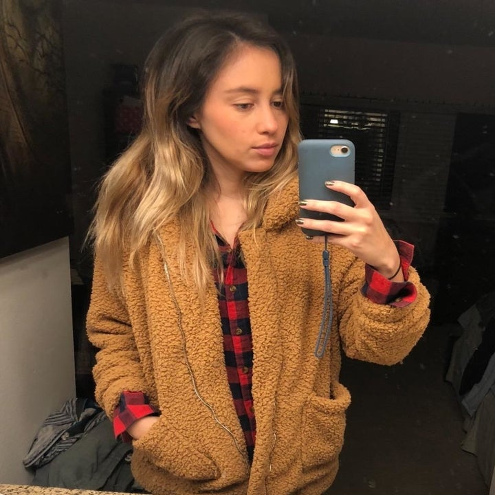 Another reviewer showing a closer view of the teddy coat