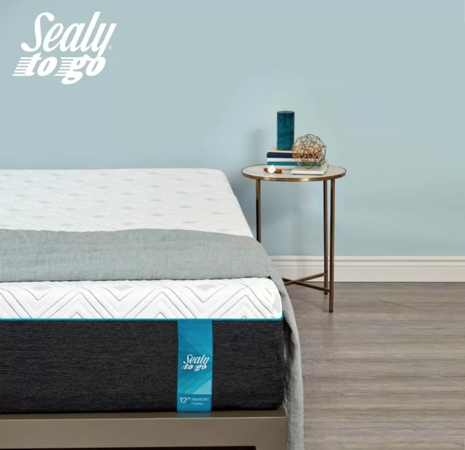 Sealy mattress with black base and white memory foam top
