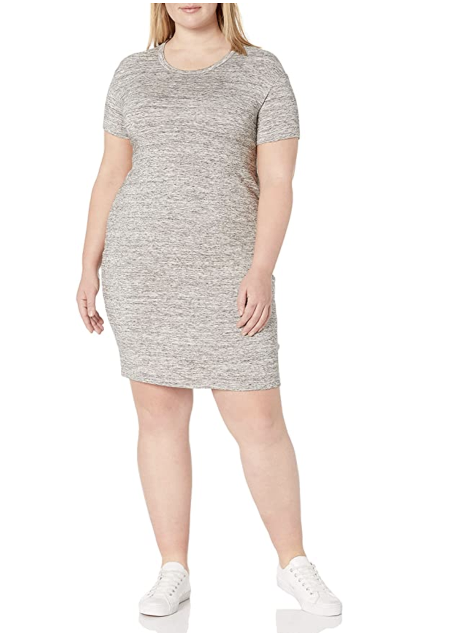 Model in above-the-knee length grey heathered short sleeved dress with crewneck