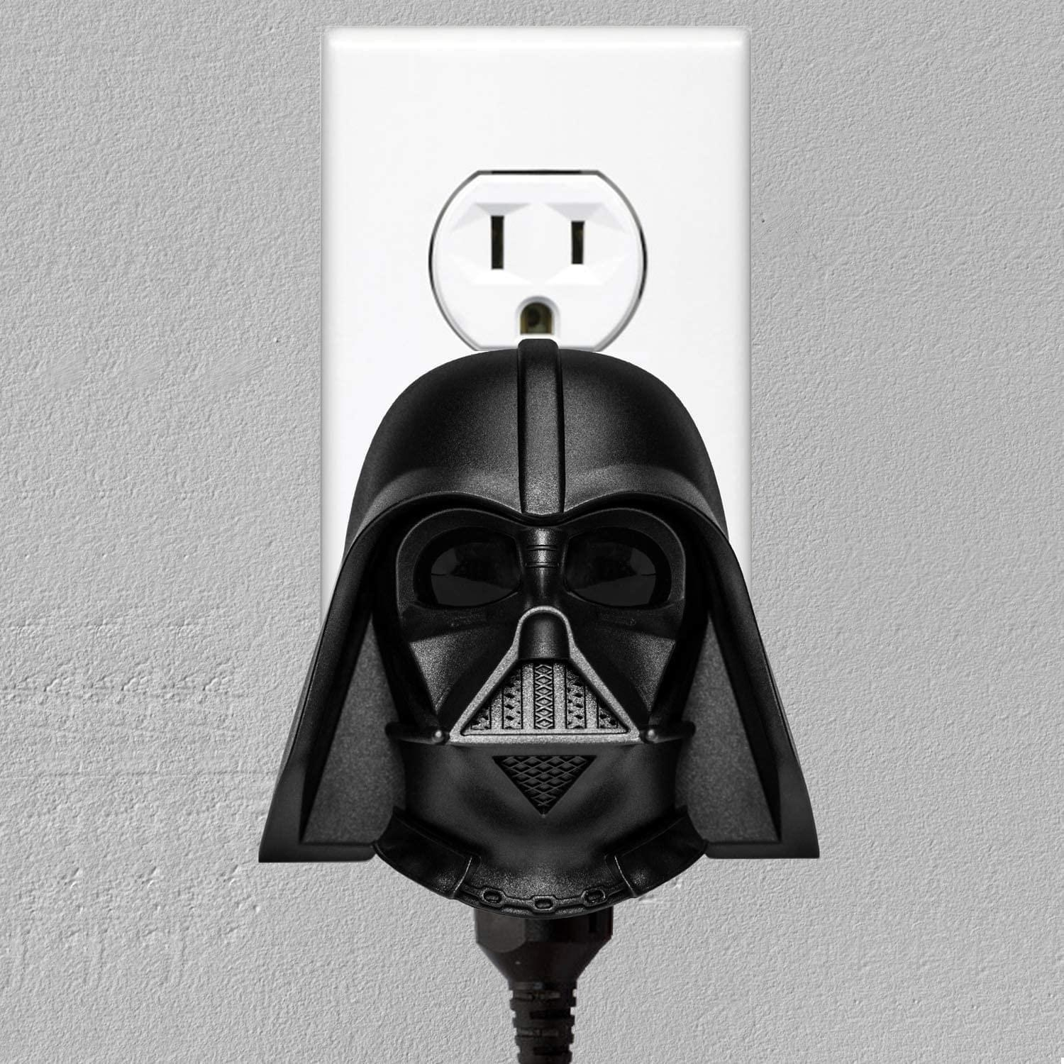 the clapper, which looks like darth vader's helmet, plugged into a wall outlet