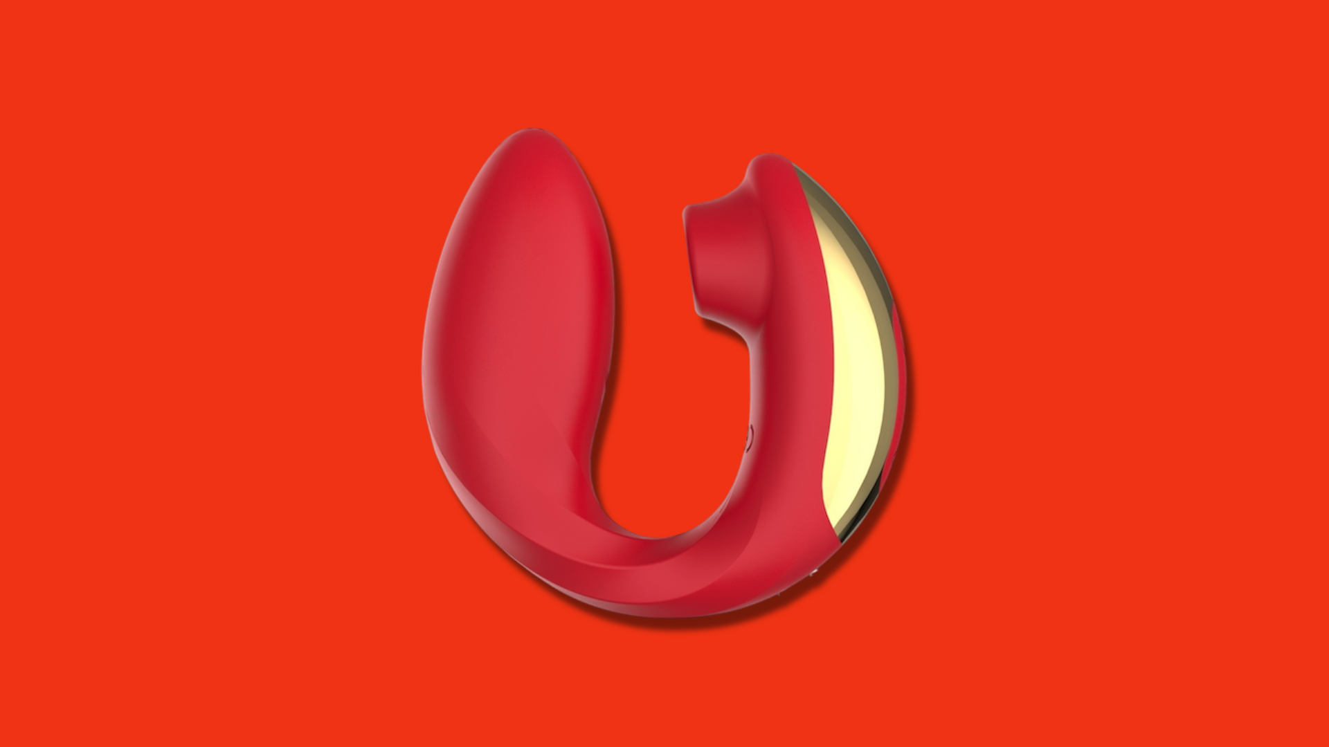 A red curved vibrator with gold accents on a red background.