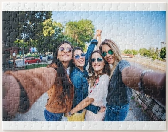 A complete jigsaw puzzle with a picture of a group of friends printed on it
