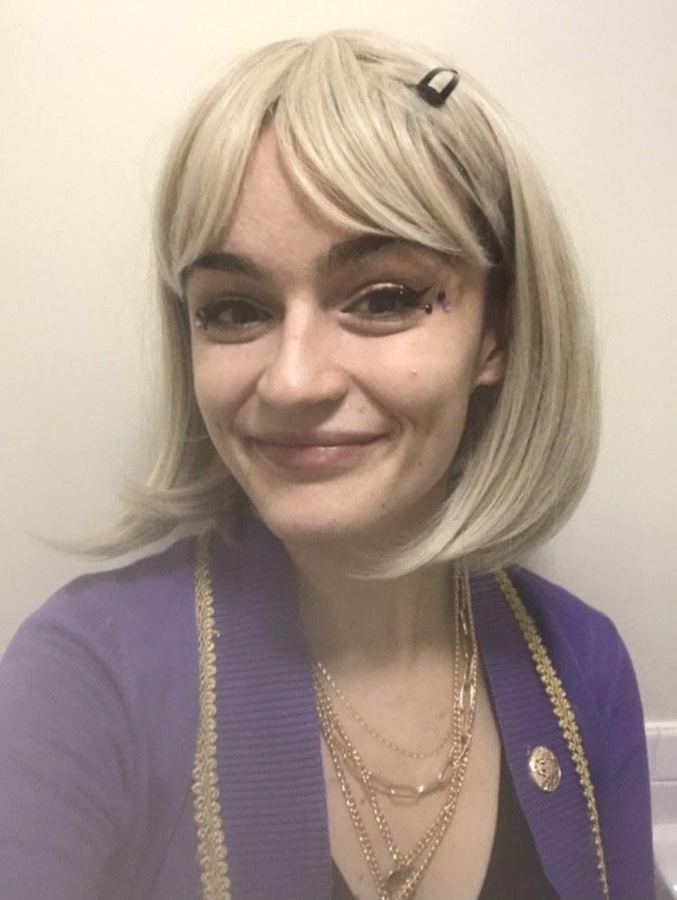 Caroline in a blond wig