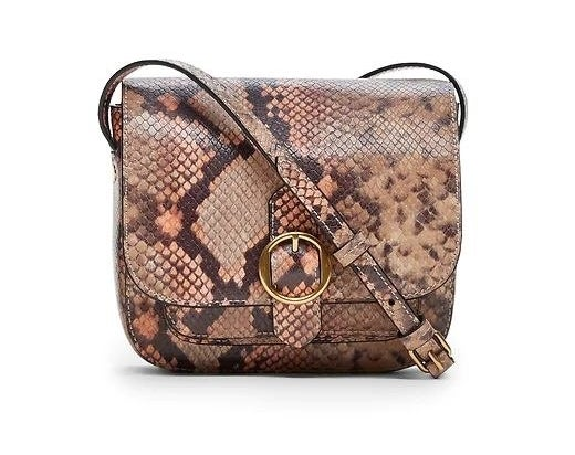 mini leather saddle bag in a snakeskin pattern