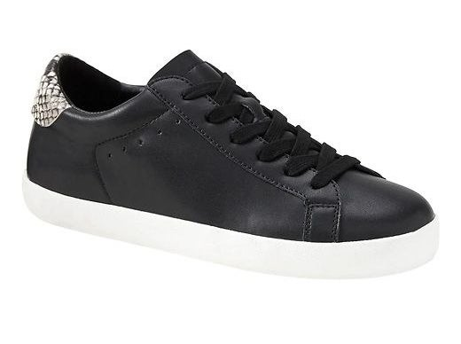 black sneakers with snakeskin back