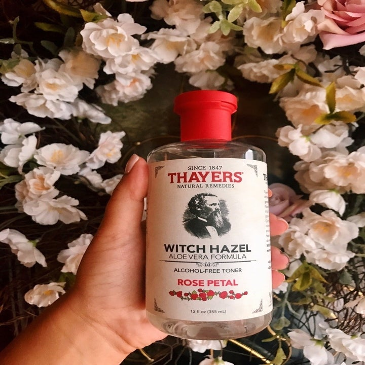 BuzzFeed Editor AnaMaria Glavan holds bottle of Thayer's Rose Petal Witch Hazel Facial Toner in their hand