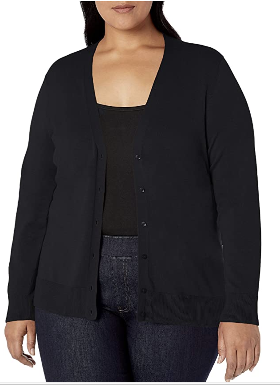 A model in a black button up cardigan