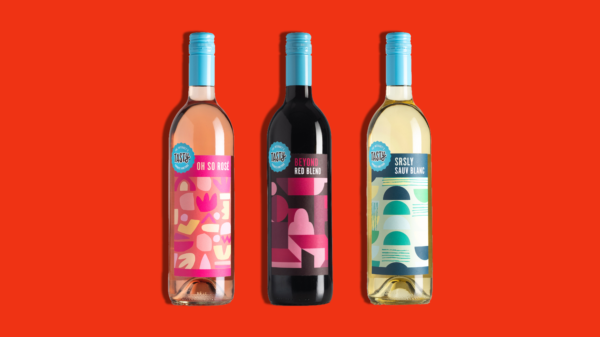 Three bottles of wine on a red background.