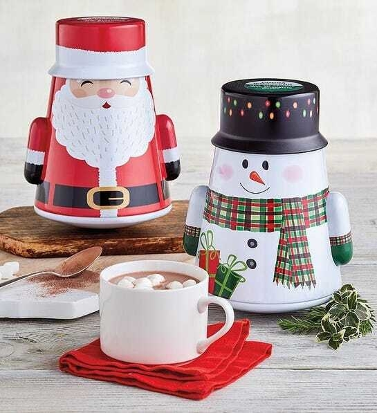 A Santa and snowman shaped tin with cocoa mix inside