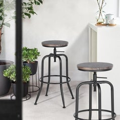 two metal and wood bar stools