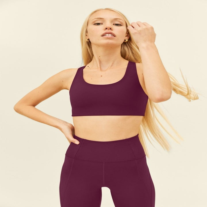 model wearing dark purple sports bra