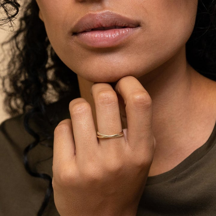 model wearing the gold duo ring