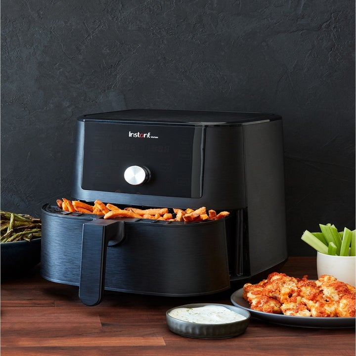 large black air fryer with fries inside