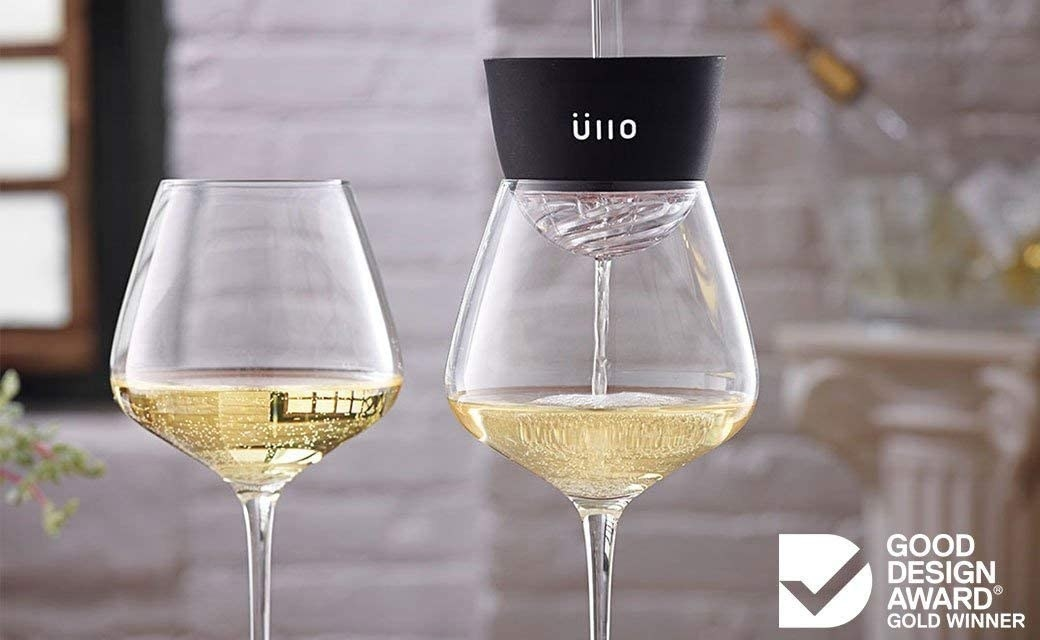wine being poured through the ullo into a glass