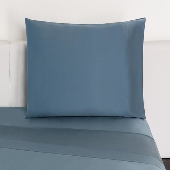 blue sheets and a pillow