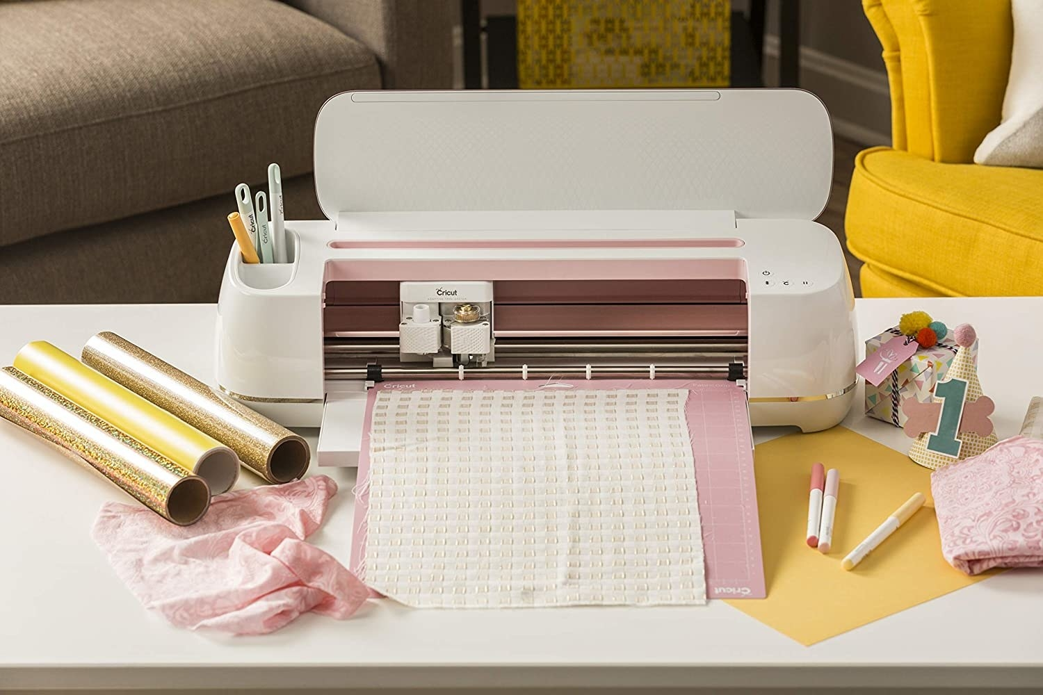 a cricut maker machine in white and pink