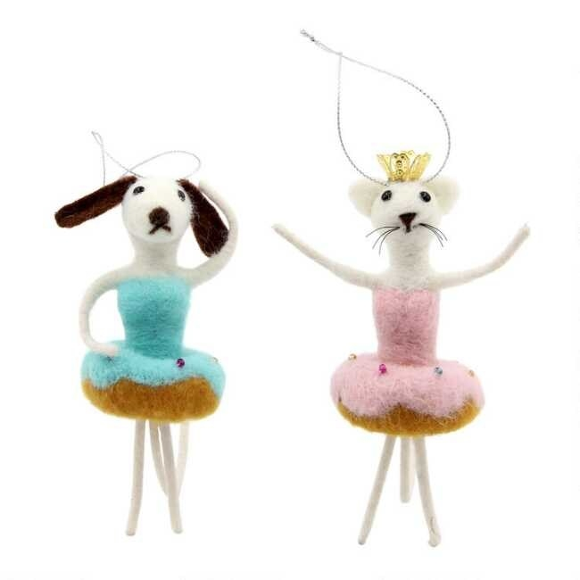 The dog and cat ornaments which are wearing blue and pink donut tutus