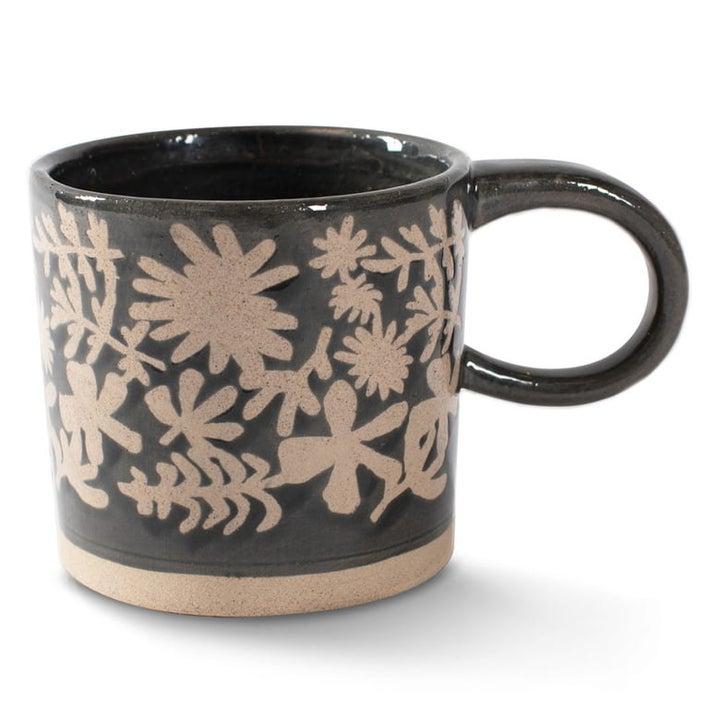 black mug with floral design