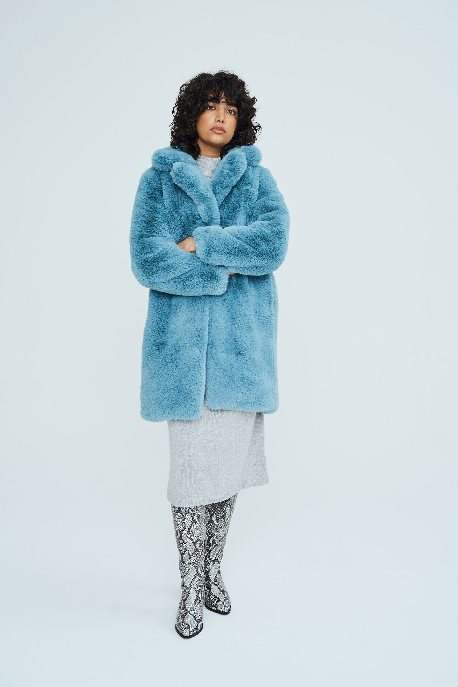 Model wearing a light blue faux fur coat