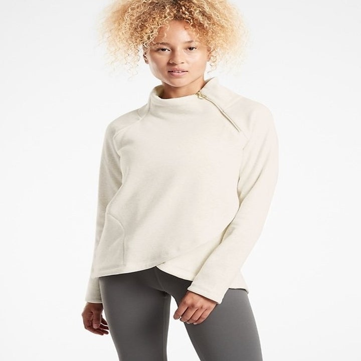 model wearing white funnel neck sweater