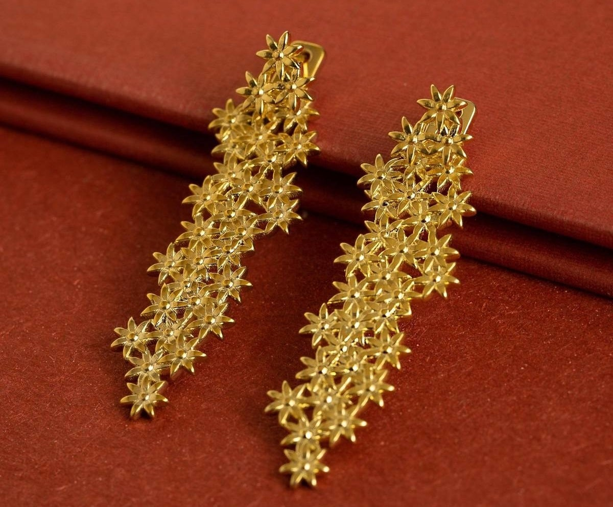 the gold flower earrings