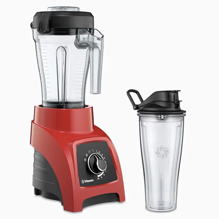 red blender with large cup and personal blending cup