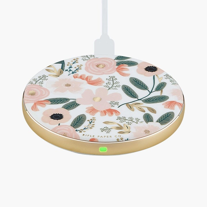 a pink floral print rounded wireless charger