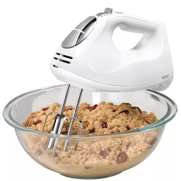 hand mixer mixing dough in a bowl