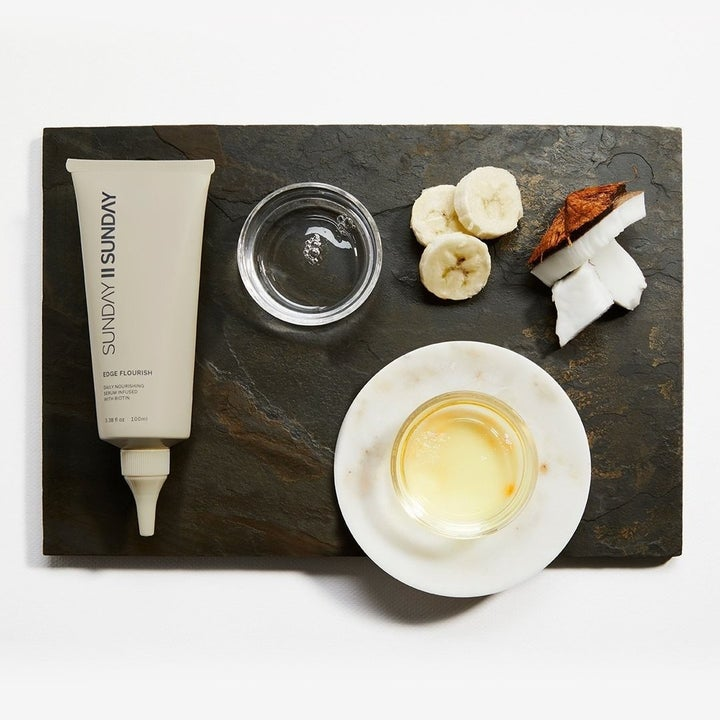 Ingredients in the edge serum laid out next to the squeeze tube