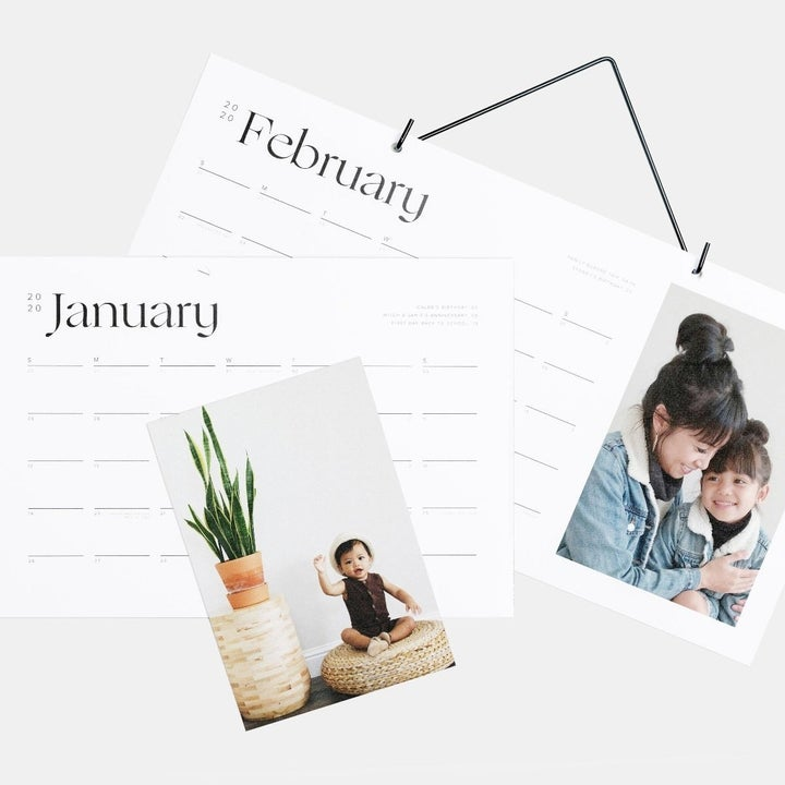 a white modern calendar with a personal photo on the side