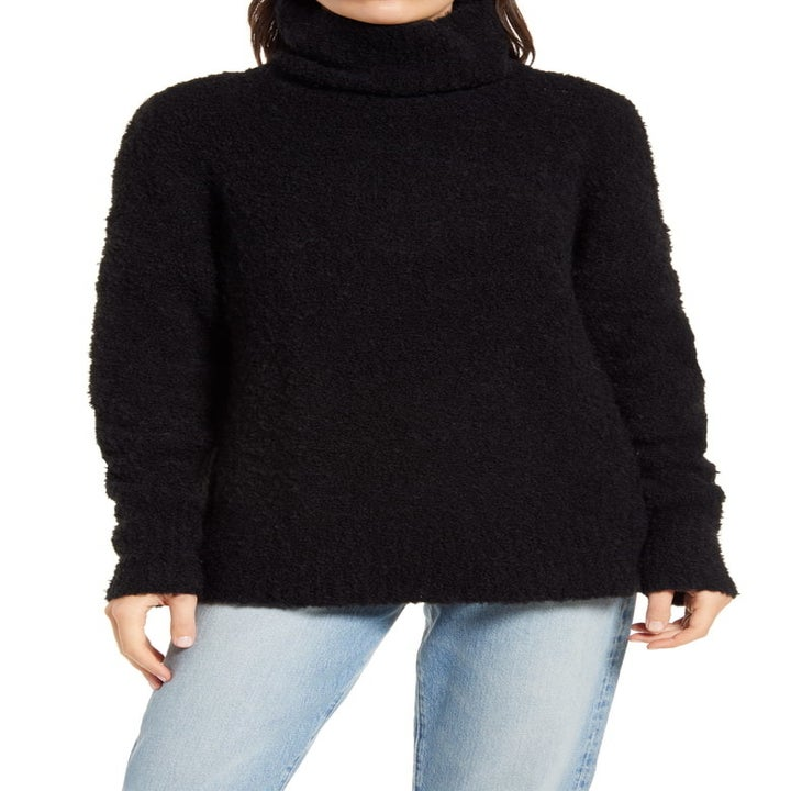 model wearing the black turtleneck sweater