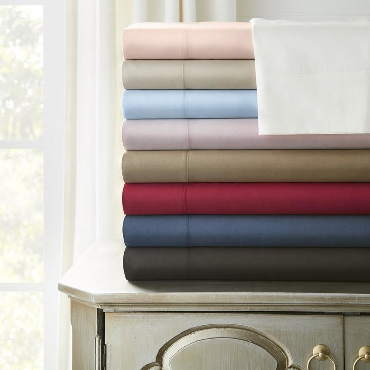 a stack of different colored sheets