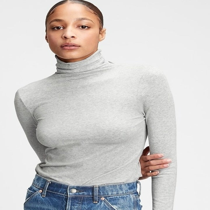 model wearing gray fitted turtleneck