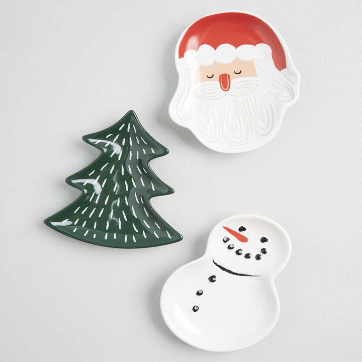 three small dishes shaped like santa, a christmas tree, and a snowman