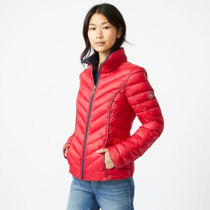 model wearing the red puffer jacket