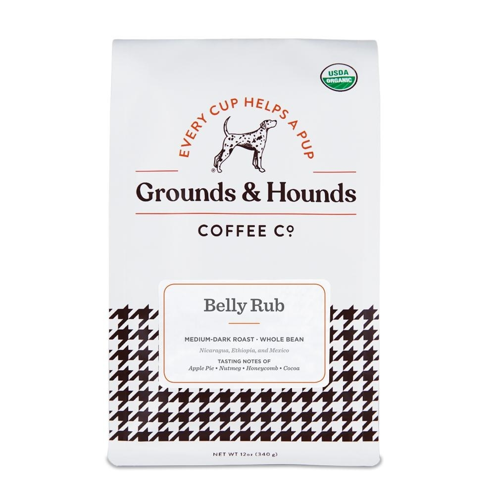 bag of coffee with houndstooth design that says every cup helps a pup above the title of the coffee which is belly rub