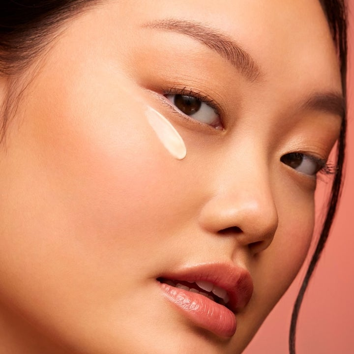 Model wearing squalane and marine algae eye cream