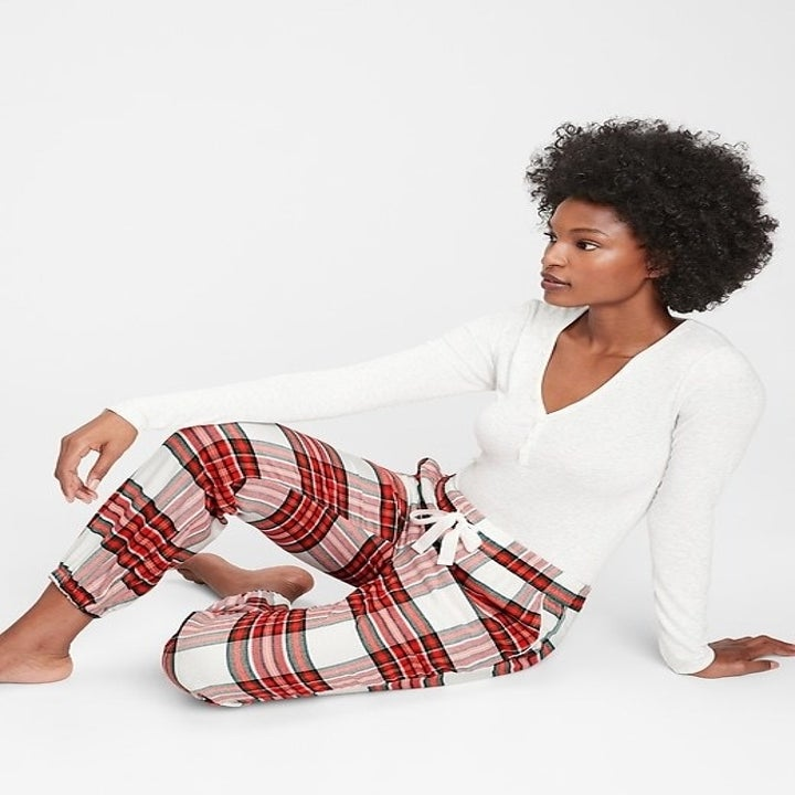 model wearing red flannel pajama bottoms