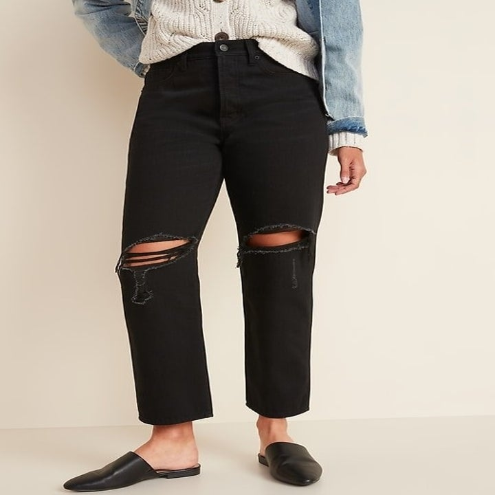 model wearing the black straight leg jeans