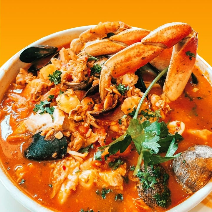 seafood dish with crab claws poking out