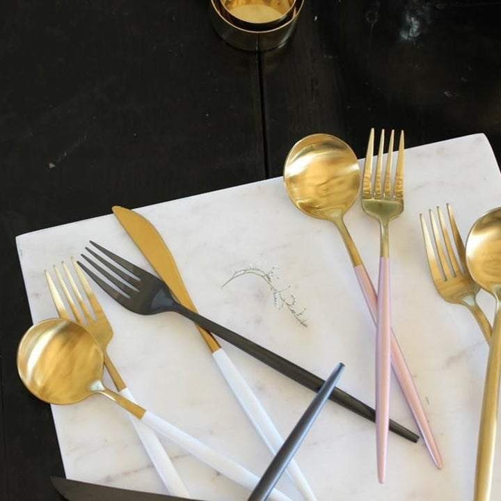 flatware with gold tops and different colored handles