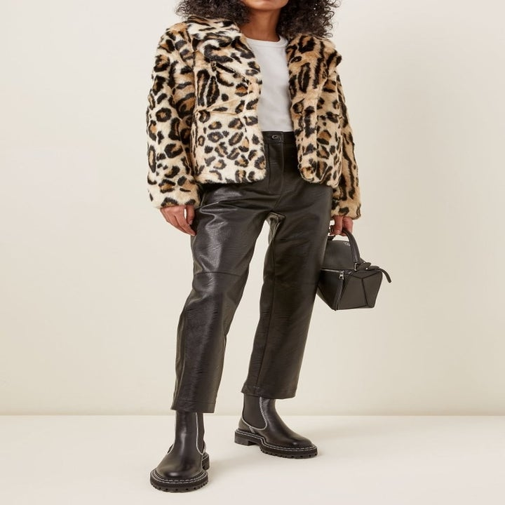 model wearing leopard faux fur coat