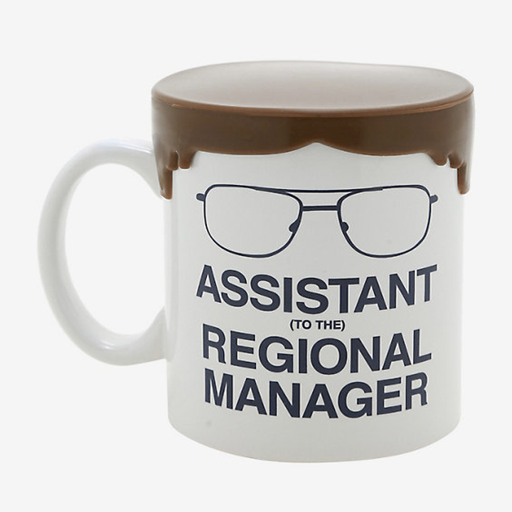 mug that says assistant to the regional manager with dwight from the office's glasses and a lid shaped like his hair