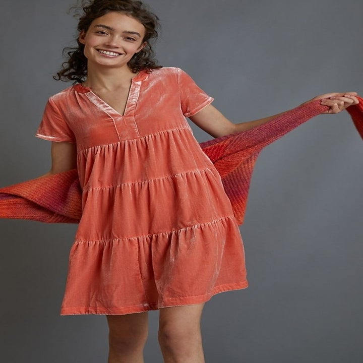 model wearing tiered pink velvet tunic dress