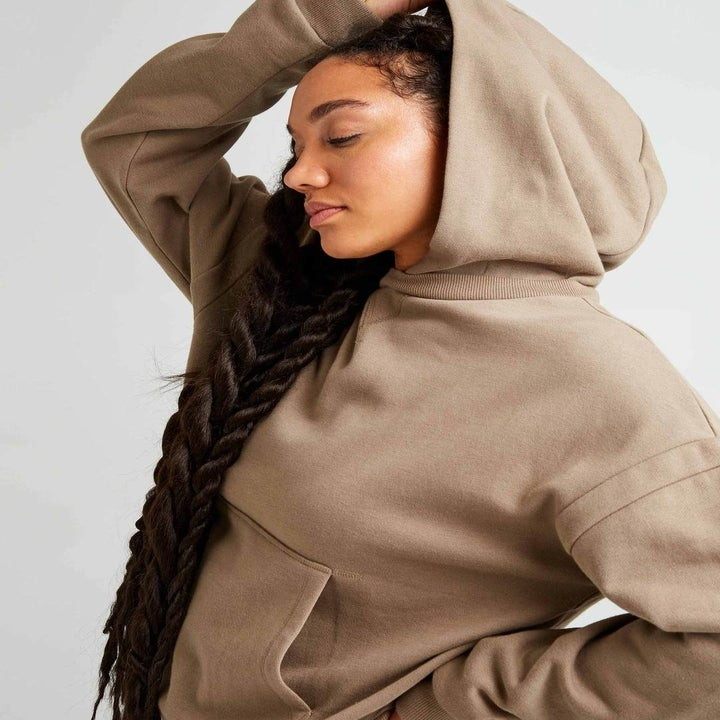 model wearing the taupe hoodie