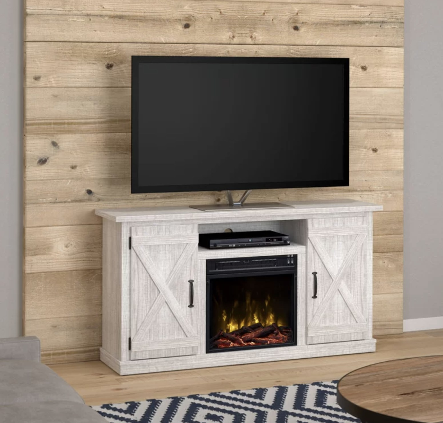 The TV stand with the fireplace lit