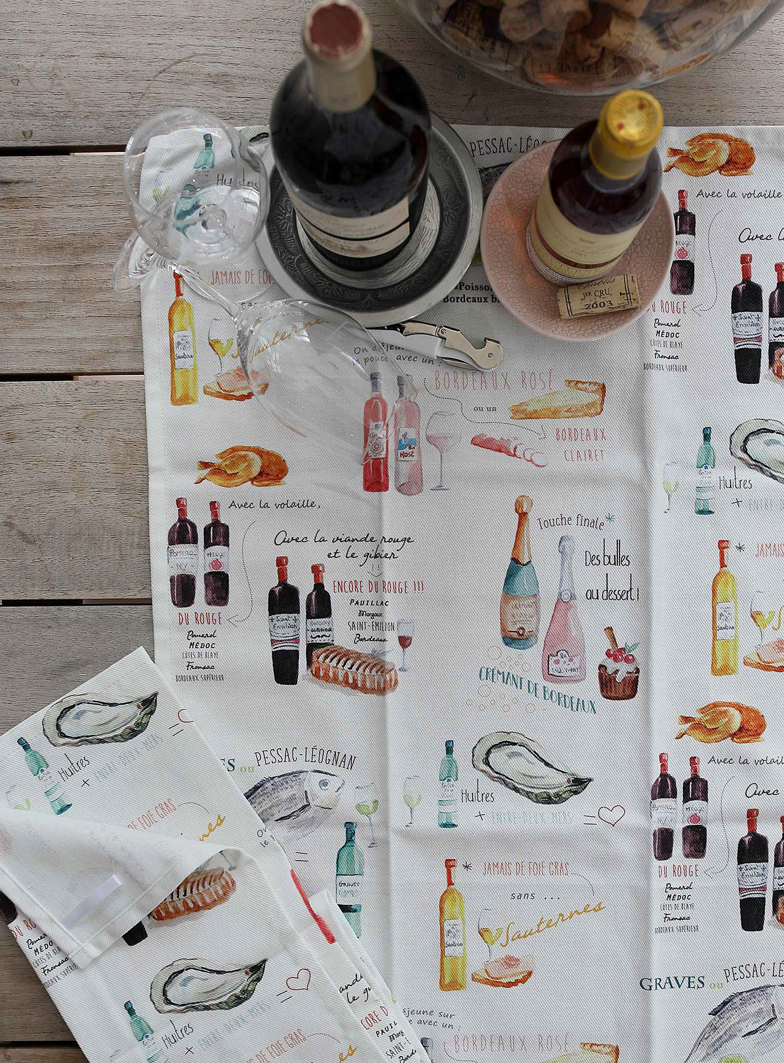 tea towel with a bottle of wine and champagne